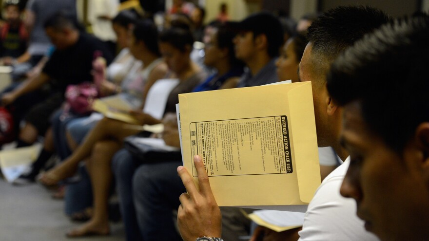 People attend an orientation class in filing up their application for Deferred Action for Childhood Arrivals program.