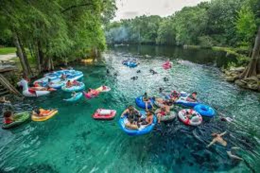 People on floats in a Florida waters.