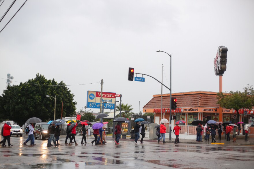 Cars honk their support for teachers as demonstrators march from Hollenbeck Middle School in Boyle Heights, Los Angeles, to a nearby intersection.