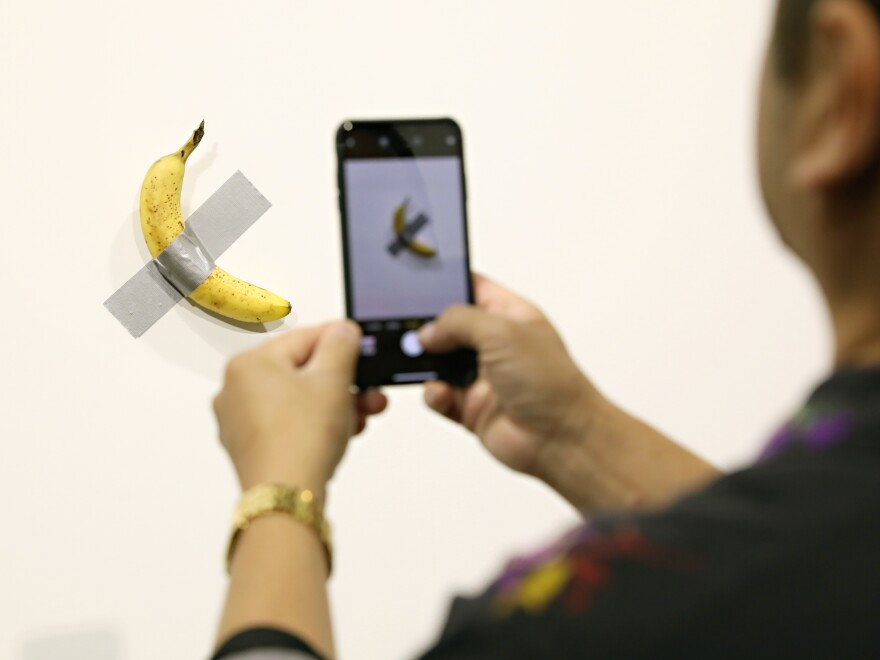 Two editions of Maurizio Cattelan's <em>Comedian,</em> a banana duct-taped to a wall, have reportedly sold for more than $100,000.