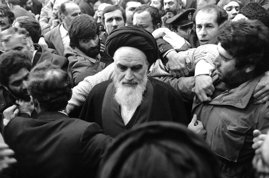 Ayatollah Khomeini was mobbed by supporters when he returned from exile in the 1979 revolution that overthrew the shah. Khomeini saw Iran's nuclear program as a symbol of Western influence and had no interest in pursuing it, at least initially.