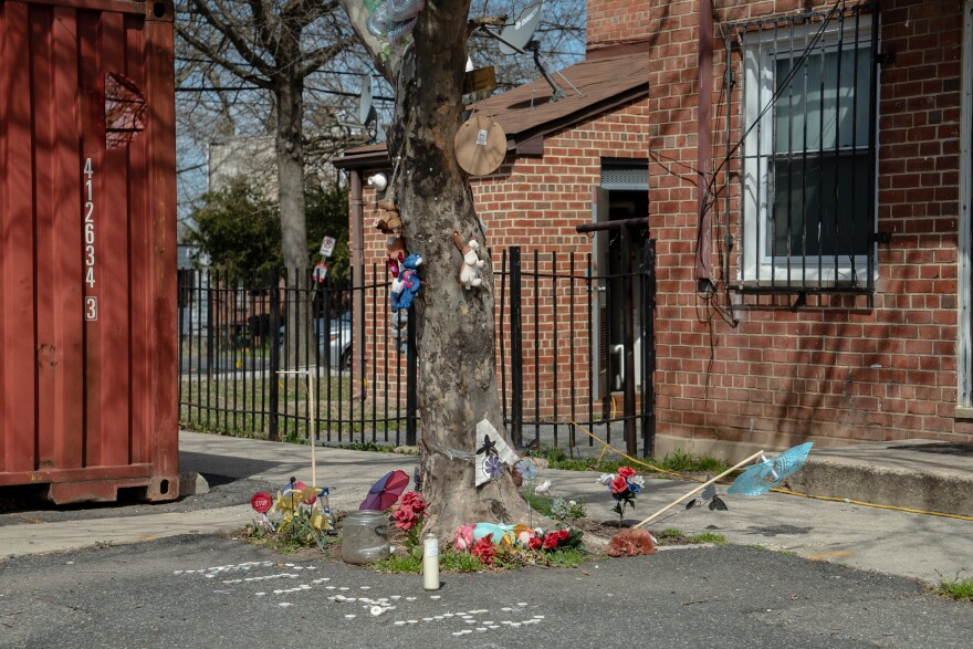 A tree in the courtyard outside is decorated with stuffed animals and pinwheels — a memorial to a 10-year-old girl who was caught in a hail of gunfire when she went out to buy ice cream last summer and died clutching a $5 bill. Her family is now suing the housing authority.
