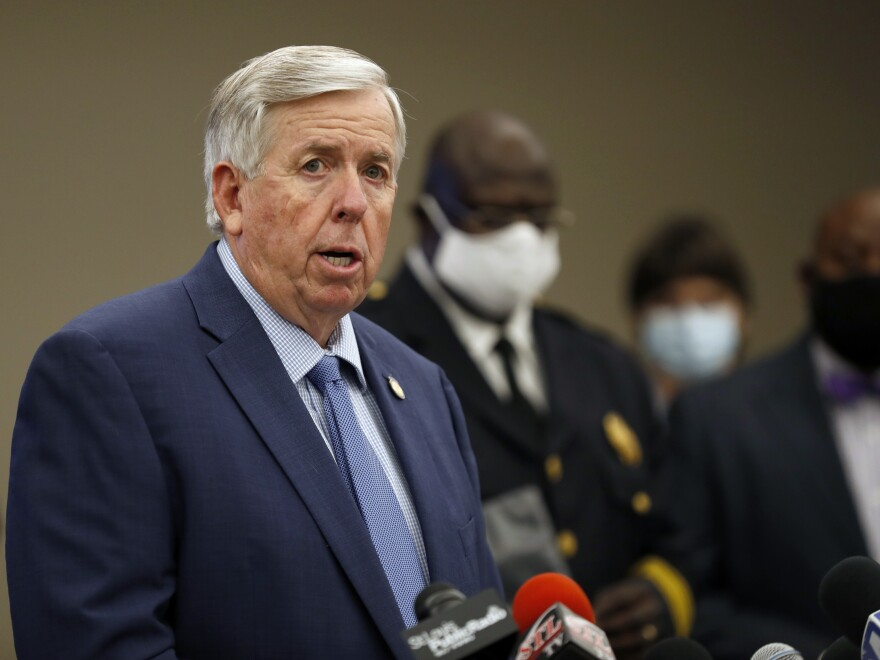 "Missouri Gov. Mike Parson, here at an August news conference in St. Louis, says he and his wife, Teresa Parson, ""are both fine"" after testing positive for the coronavirus."