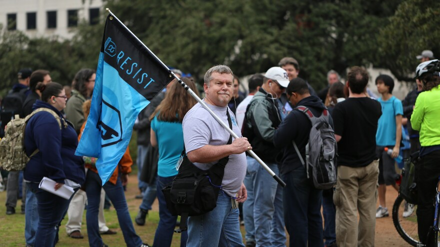 People gather to play Ingress in Austin, Texas. The video game has been downloaded 2 million times and is popular in the U.S. and Europe.