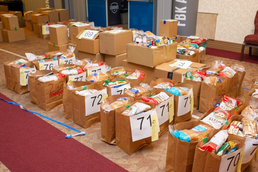"""Kris Horlacher, Executive Director of Shoes 4 the Shoeless, says that providing families with three weeks of food at a time will help """"flatten the curve"""" by providing food security and allowing people in need to venture out to stores less often."""