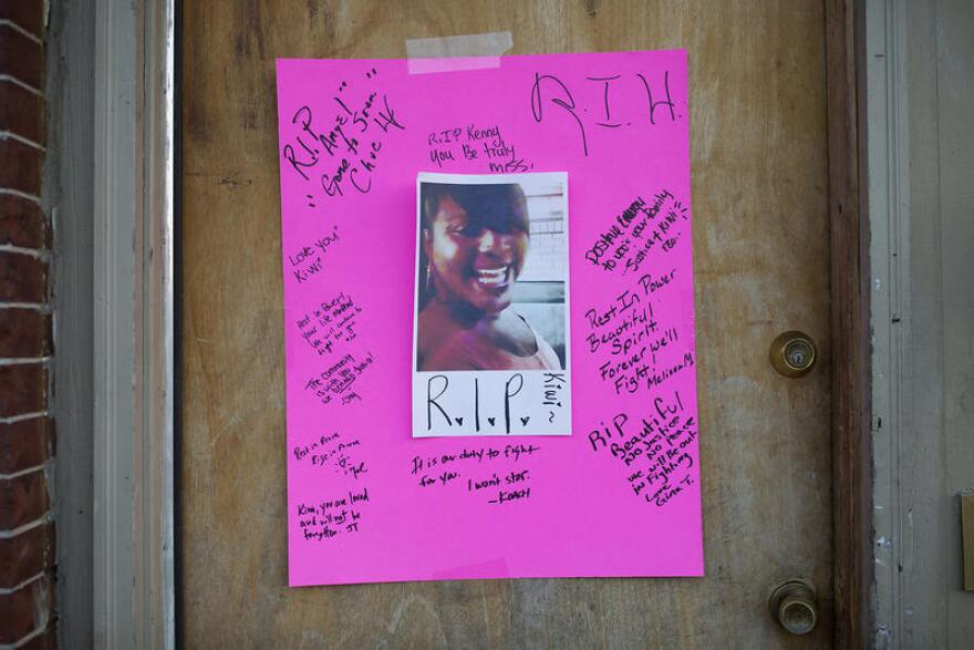 People left messages of love on a poster on the door to the apartment where Herring was killed by police, as seen in this file photo.