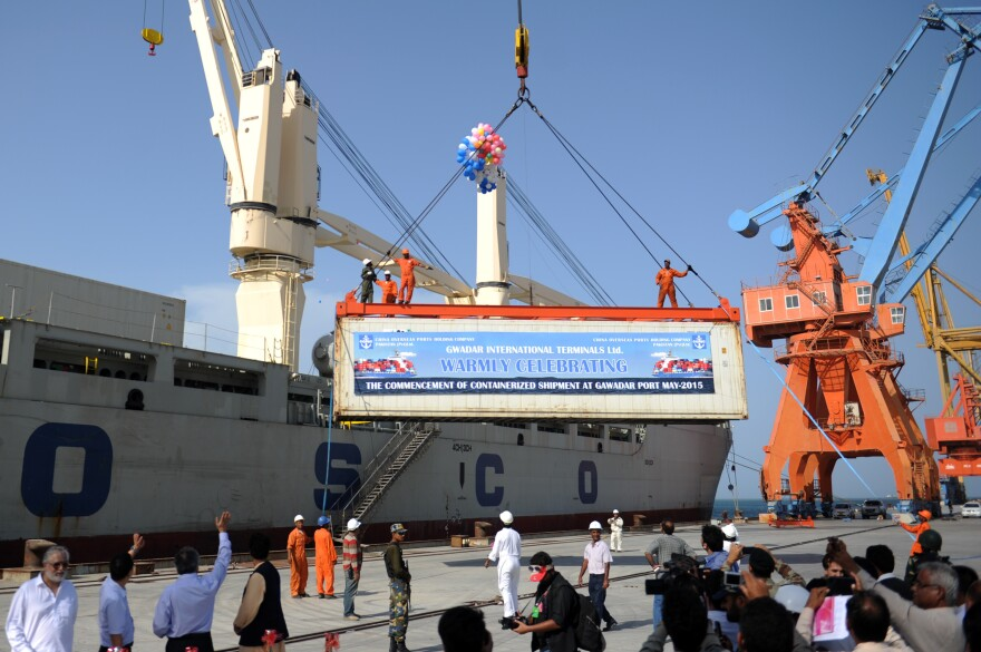 A container is loaded onto a ship during the inauguration of container service in Gwadar on May 11. China and Pakistan have agreed to build an economic corridor that will run from the Pakistani port to western China.