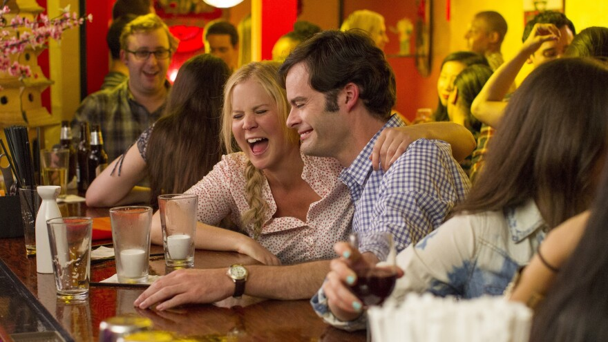 Amy Schumer and Bill Hader in <em>Trainwreck.</em>