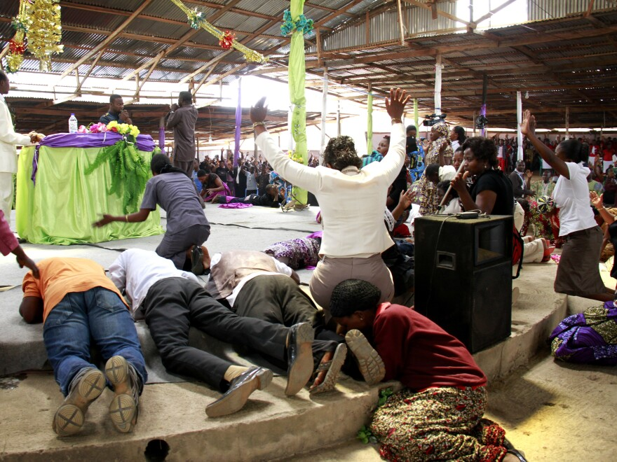 People flood the stage for physical and spiritual healing at Ramah Christian Center, one of the fastest-growing Pentecostal churches in Bamenda.
