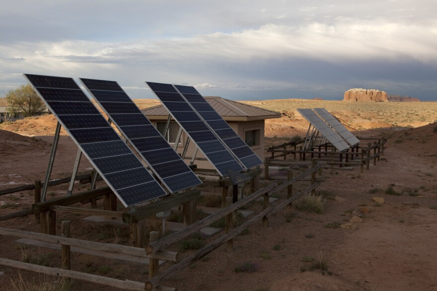 Photo of solar panels in desert.