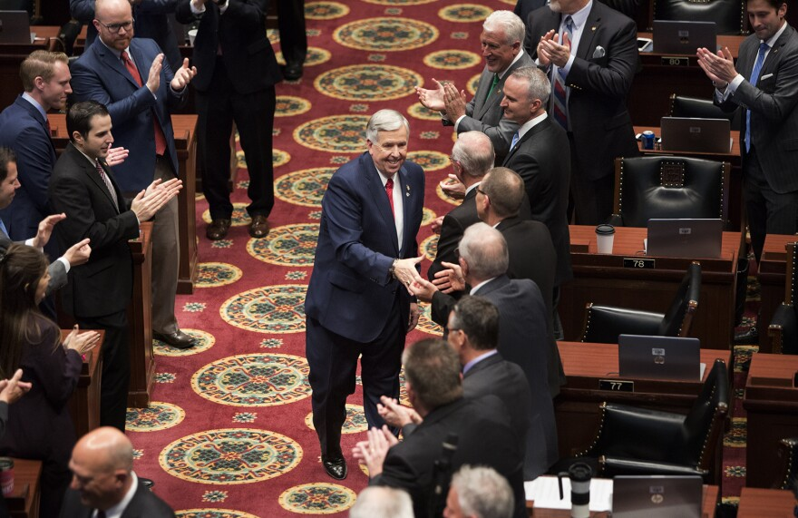Missouri Gov. Mike Parson greets members of the house before delivering his first State of the State address Wednesday afternoon.