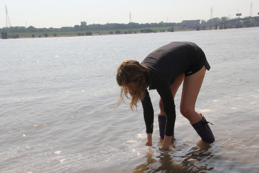 Missouri Confluence Waterkeeper Rachel Bartels taking a sample of the Mississippi River near the arch in Sept. 2019.