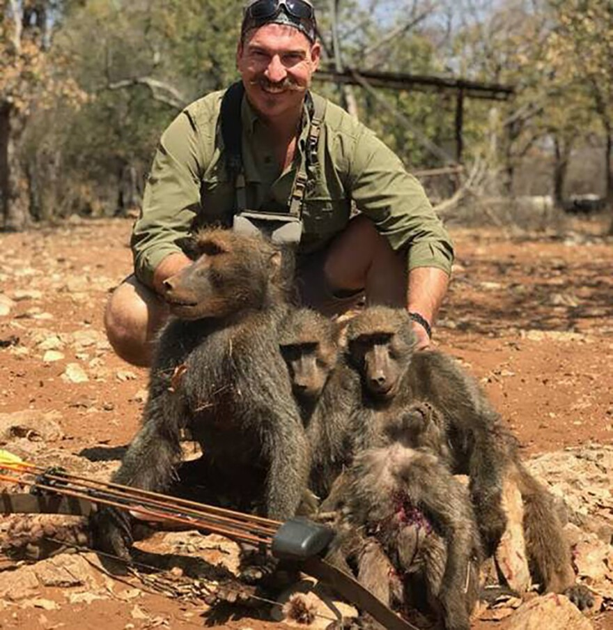 Idaho Fish and Game Commissioner Blake Fischer poses with baboons he says he killed on a guided hunting trip to Namibia last month.