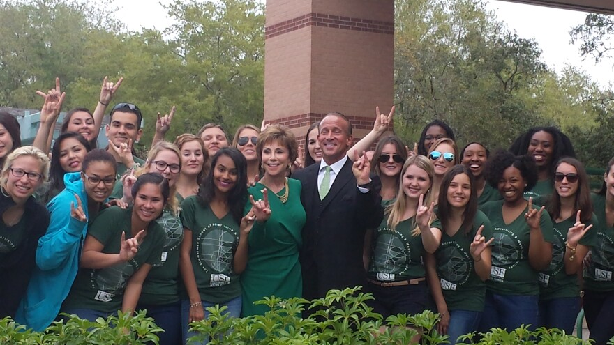 Jordan Zimmerman, seen with USF President Judy Genshaft and students at the naming of the Zimmerman School of Advertising and Mass Communications in 2015, has been named the chair of the USF Board of Trustees.