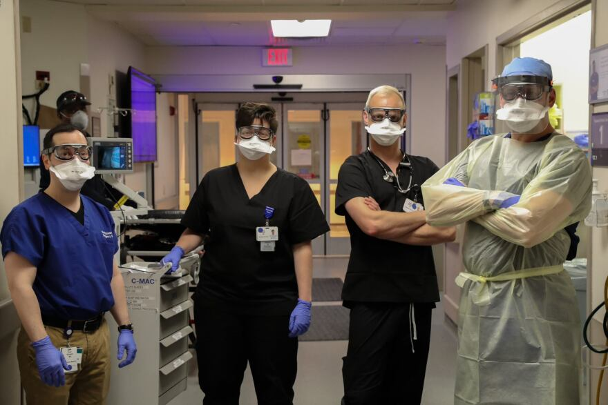 Emergency room workers at Barnes-Jewish Hospital pose in protective gear that keeps them safe from contracting COVID-19.