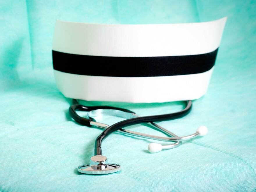Nurse's cap and stethoscope.