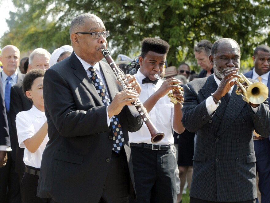 Musicians lead the procession during a wreath-laying ceremony at the Hurricane Katrina Memorial site in New Orleans on Saturday.