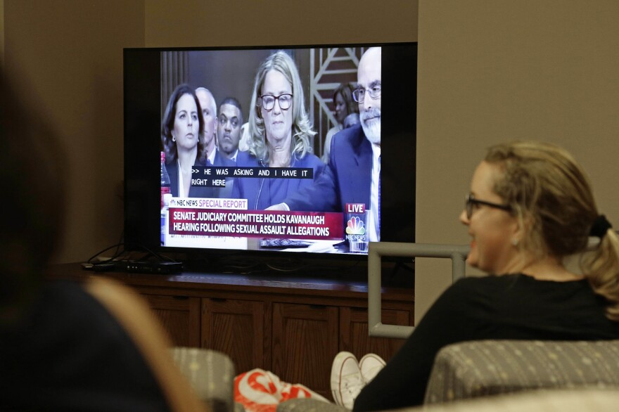 Students at the University of North Carolina School of Law in Chapel Hill, N.C. watch Christine Blasey Ford as she testifies before the Senate Judiciary Committee Thursday, Sept. 27, 2018. (AP Photo/Gerry Broome)