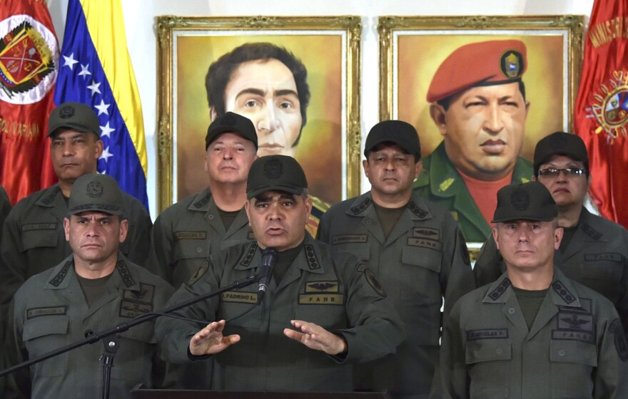 "Venezuelan Defense Minister Vladimir Padrino delivers a speech while surrounded by military men in Caracas on Tuesday. Padrino reiterated the military's ""unrestricted obedience, subordination and loyalty"" to President Nicolás Maduro."