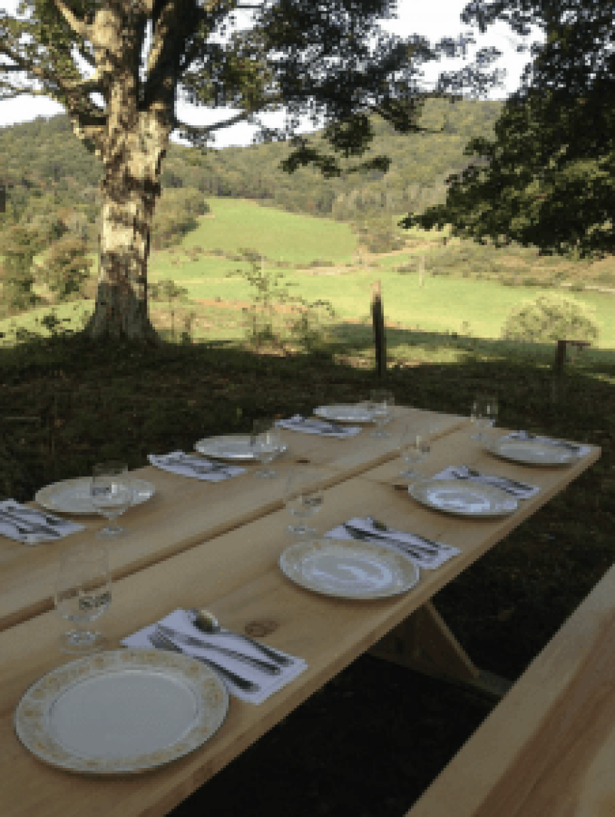 The tables were set for a dinner conversation Bourdain had with local cooks, farmers, folklorists and food justice advocates during his visit to Lost Creek Farm last fall.