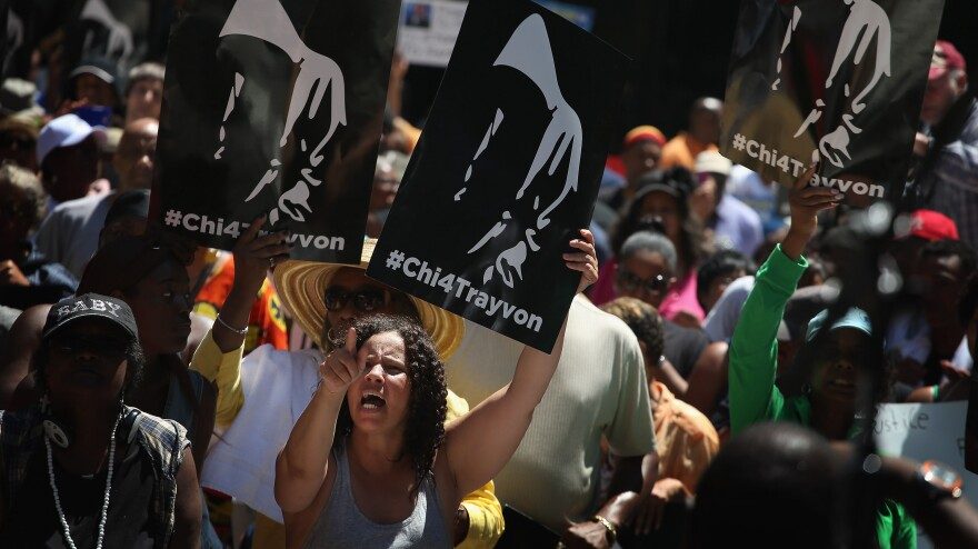 "Demonstrators attend a ""Justice For Trayvon"" rally in Chicago on Saturday."