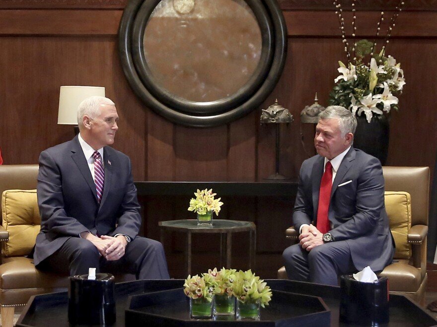 U.S. Vice President Mike Pence, (Left), meets with King Abdullah II at the Husseiniya Palace in Amman, Jordan on Sunday.