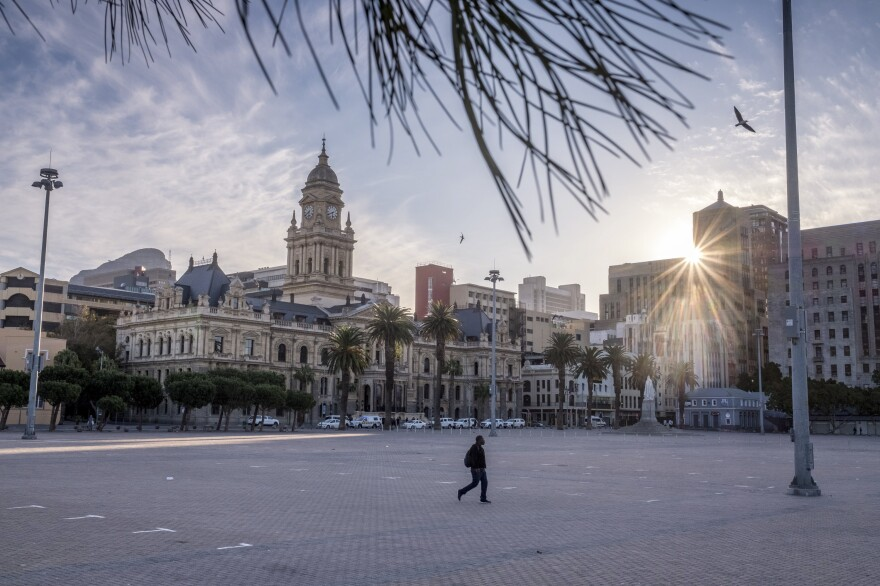 A man walks across a deserted square in central Cape Town, South Africa, two weeks into the country's coronavirus lockdown.