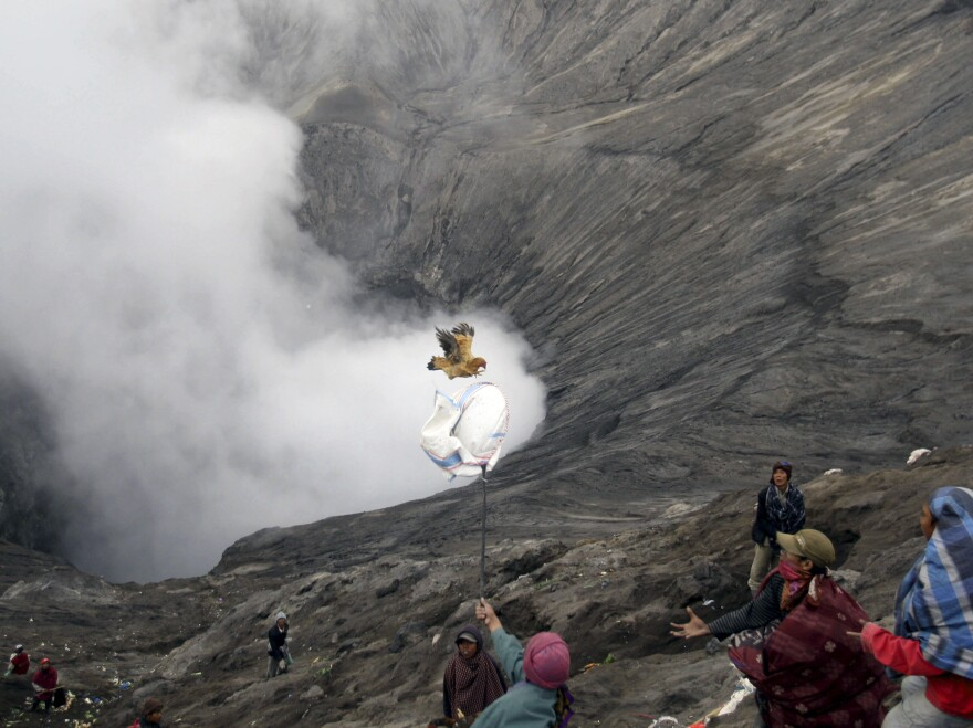 Hindu devotees make an offering to the gods at the edge of a volcano during a festival in East Java in July. Indonesia is among the most volcanically active regions in the world.