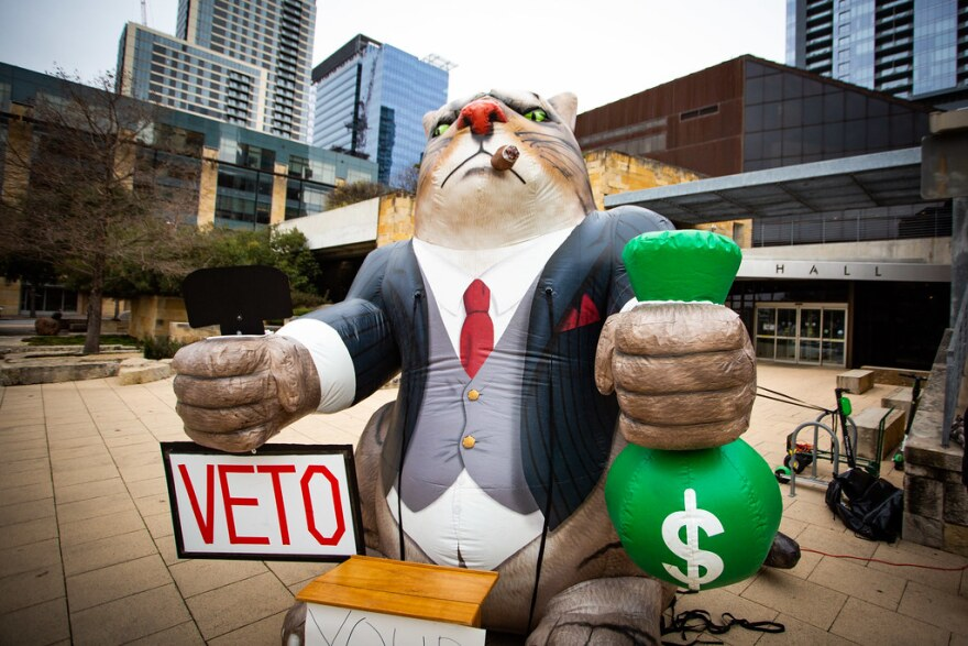 A 14-foot inflatable cat was set up in front of City Hall ahead of City Council's vote to finalize May's citywide ballot.