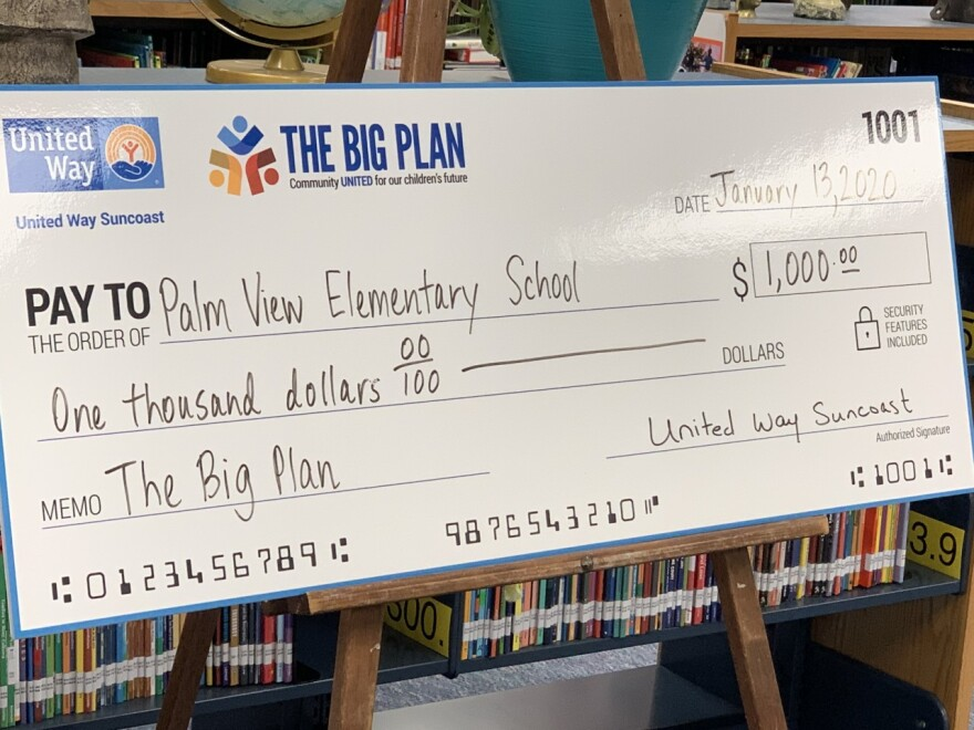 large check for $1,000