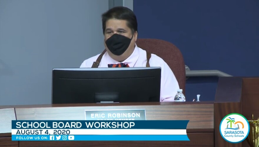 Sarasota School Board Member Eric Robinson wears a face mask at a workshop on August 4.