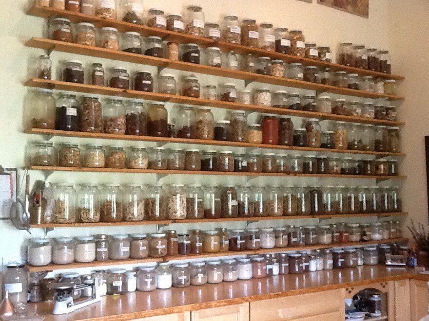 Jars of dried roots, leaves and flowers line the shelves of the Blue Ridge Center for Chinese Medicine.