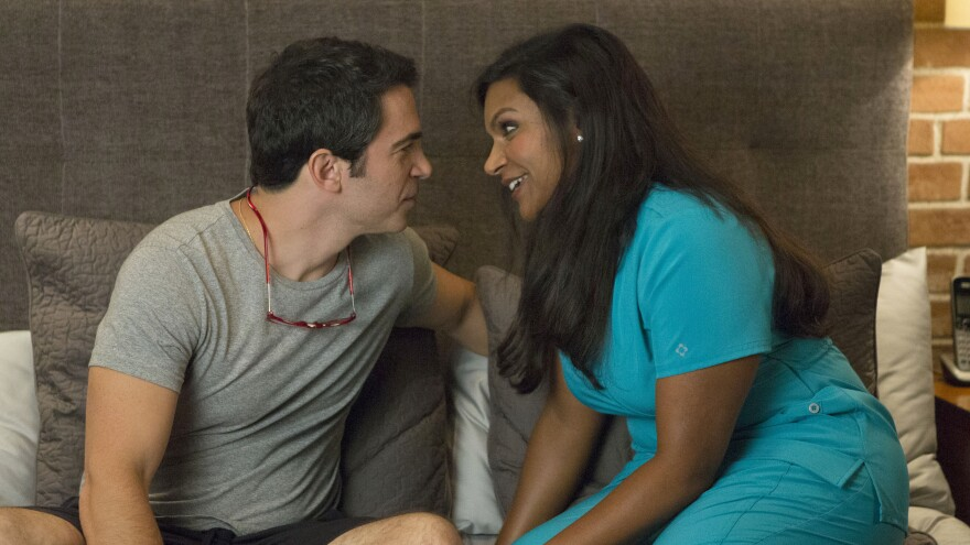 Danny (Chris Messina) and Mindy (Mindy Kaling) find themselves in a new position in the premiere of <em>The Mindy Project</em>.