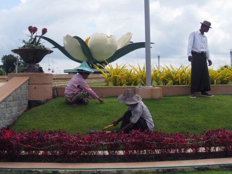 In Naypiydaw, armies of laborers in long-sleeve shirts and broad-brimmed hats to protect them from the scorching sun take care of lush new gardens — doing much of the work by hand.