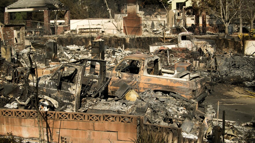 Rubble and burned vehicles line properties in Ventura scorched by fire on Dec. 6, 2017.