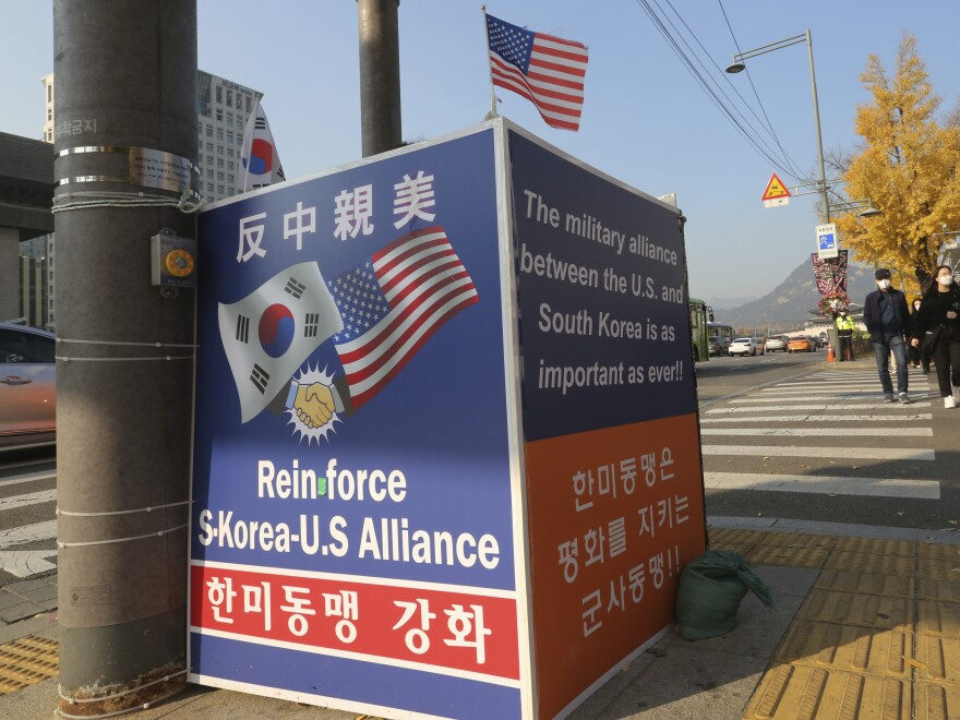 "A billboard supporting the alliance between South Korea and the U.S. is displayed near the U.S. Embassy in Seoul, South Korea, on Thursday. The banner at top reads, ""Anti-China and Pro-the U.S."""