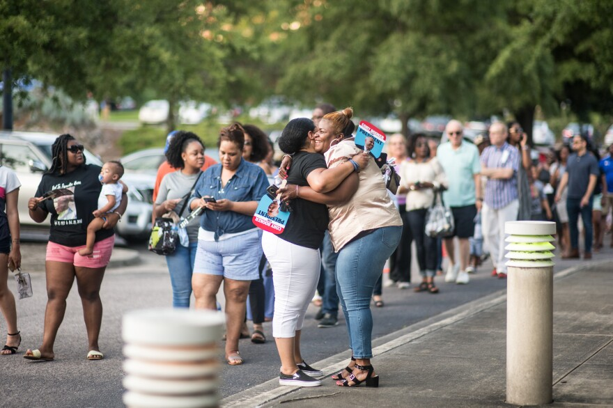 People wait in line outside of Jim Clyburn's World-Famous Fish Fry. Black women are the most consistent Democratic voters of any bloc of the electorate but turnout among black women can be make or break for Democrats.