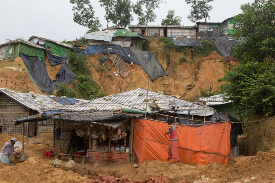 Shelters in the Balukhali refugee camp sit at the base of steep cliffs of sand.
