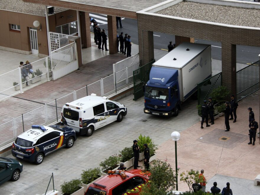 A vehicle that picks up hospital waste arrives at Teresa Romero Ramos' house in Alcorcon, outside Madrid, on Wednesday. The Spanish nurse was the first case of human-to-human Ebola contagion in Europe.