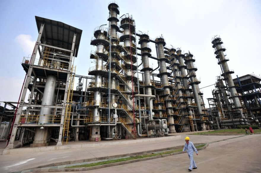 A worker walks by at an oil refinery of China's Sinopec, in Wuhan, central China's Hubei province.