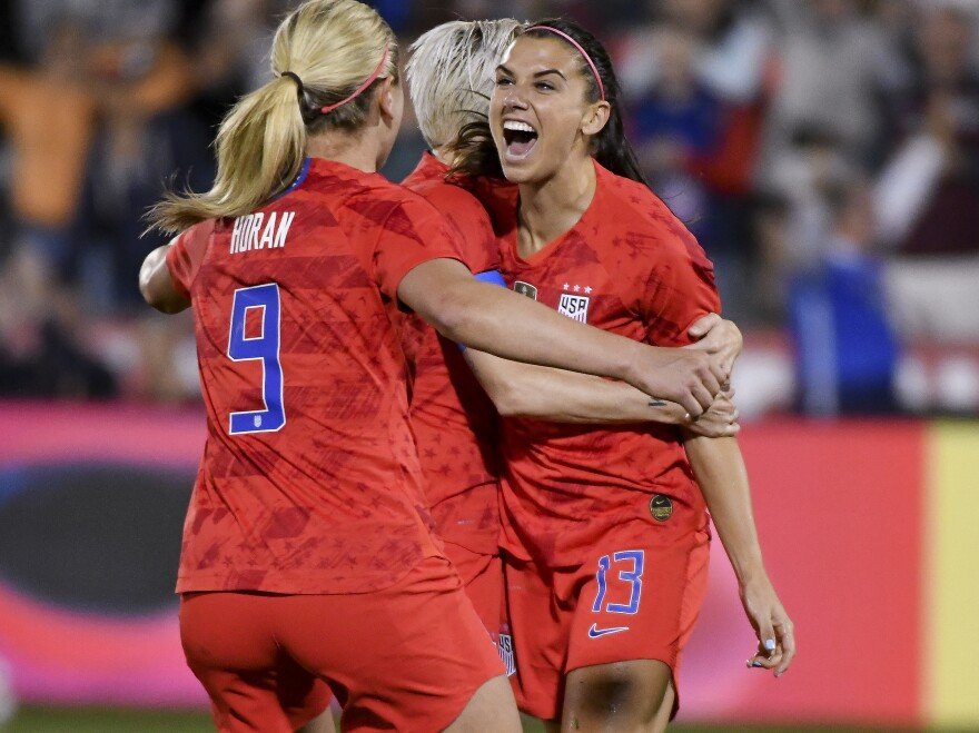 Alex Morgan, right, celebrates with Lindsey Horan and Megan Rapinoe after scoring her 100th international goal on April 4 in Colorado. The three will represent the U.S. at the Women's World Cup next month in France.