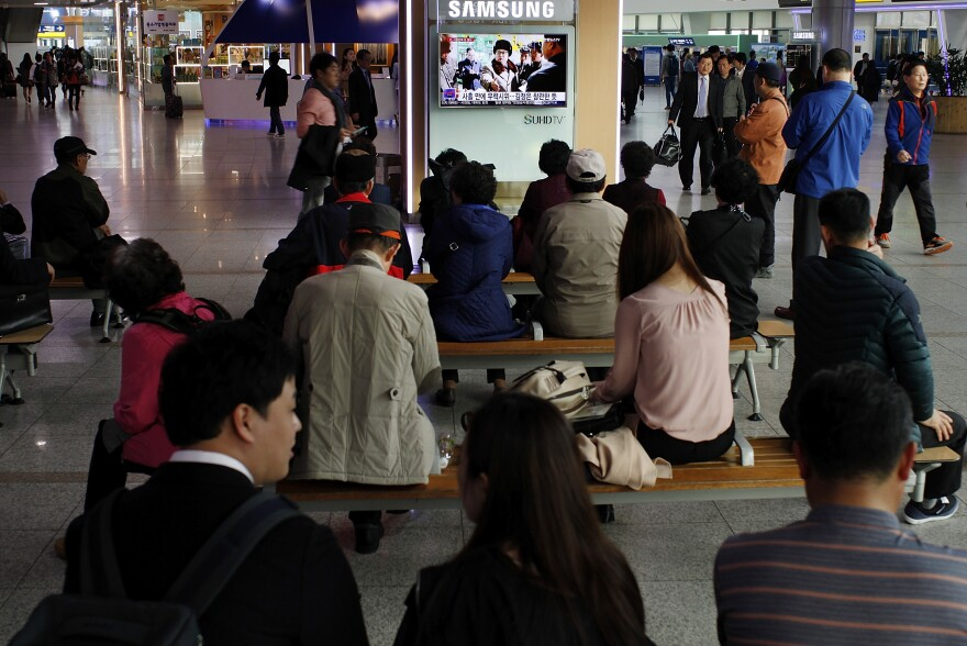 South Korean people watch a television broadcast at the Seoul Railway Station earlier this month reporting North Korea's surface-to-air missile launch.