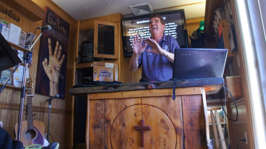 Michael DeBay conducts a Sunday service to drivers inside the truck stop chapel off Interstate 10 in southern California. (Saul Gonzalez/KCRW)