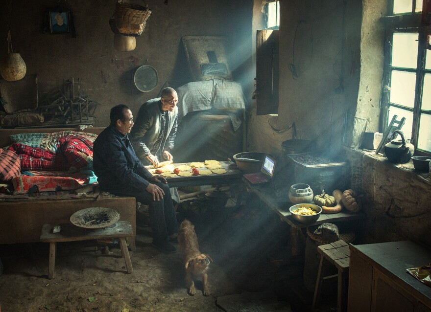 """Two brothers live in a traditional yaodong, or """"kiln cave,"""" carved into a hillside on the Loess Plateau in central China. The earth-lined walls have good insulation, enabling residents to survive cold winters."""