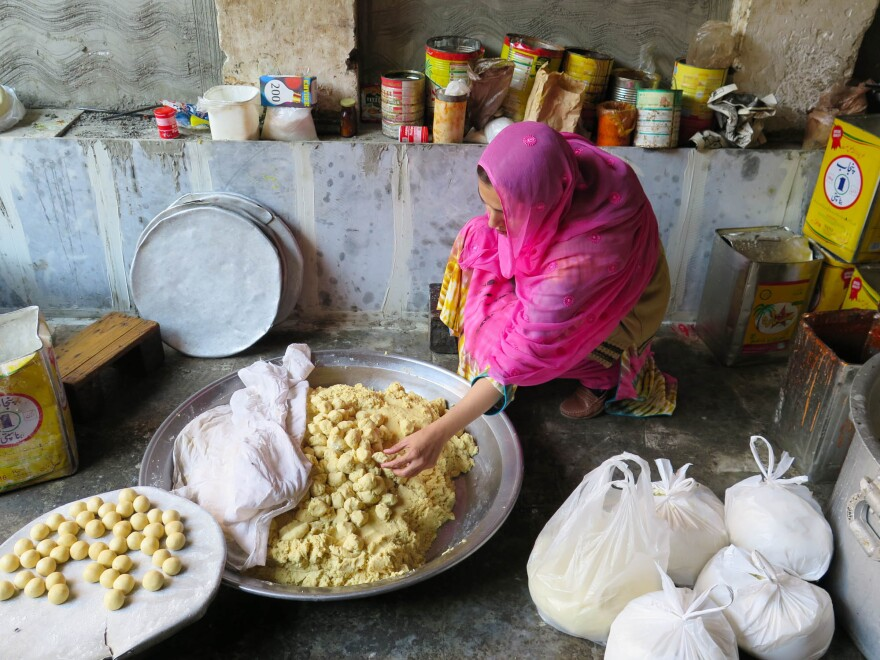 "Ayesha Mumtaz inspects food during a raid on a backyard sweets factory in Lahore, Pakistan. Her campaign to clean up the kitchens and food factories of Pakistan has earned her the nickname ""The Fearless One."""