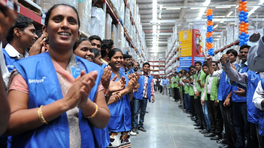 September 2012: Employees celebrate the opening of a Best Price Modern store in Hyderabad, India. Bharti Enterprises manages that and other such stores, which Wal-Mart has invested in.