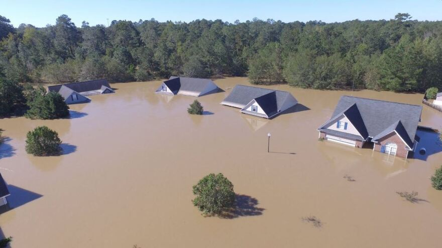 This image of flooded homes in Hope Mills, N.C., prompted a dramatic rescue.