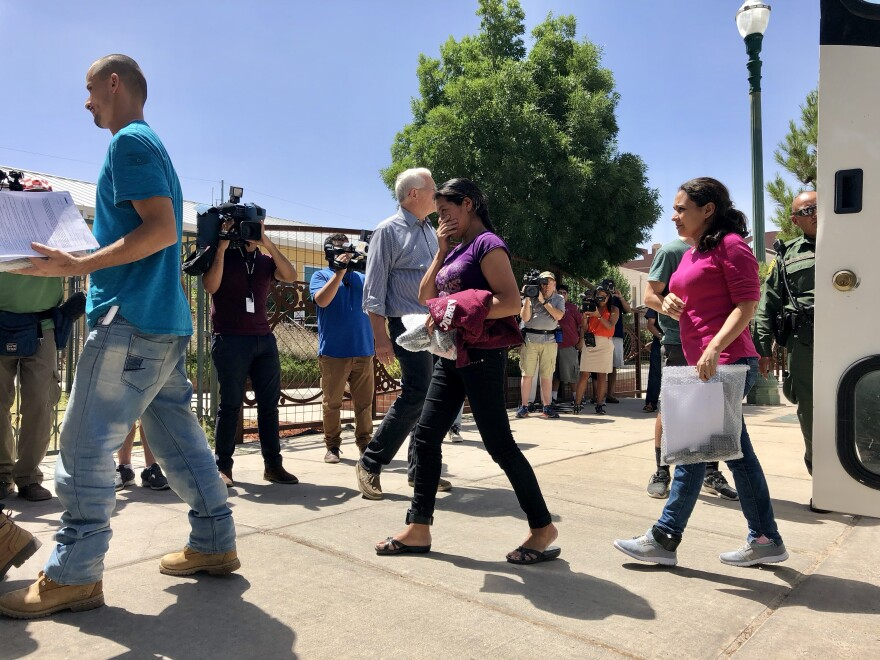 A Department of Homeland Security bus pulled up outside Annunciation House, a shelter for migrants and refugees in El Paso, Texas, on Sunday. Parents filed off and walked into the shelter, some exposing their GPS ankle monitors.