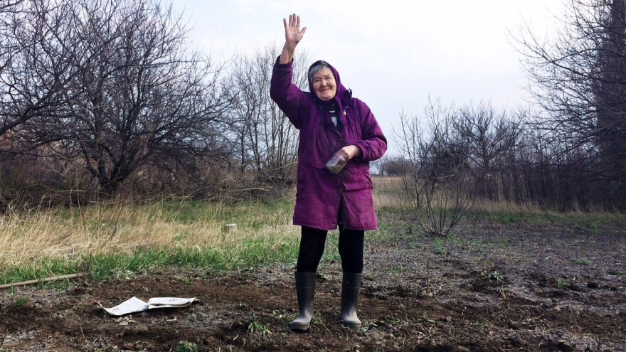 """In the rundown Ukrainian town of Perevalsk, near the Russian border, 80-year-old Lida Vasilivna has just planted a garden. """"Business just went belly up,"""" she says about her town's hard times — after asking, """"Are you gonna put this granny on TV?"""""""