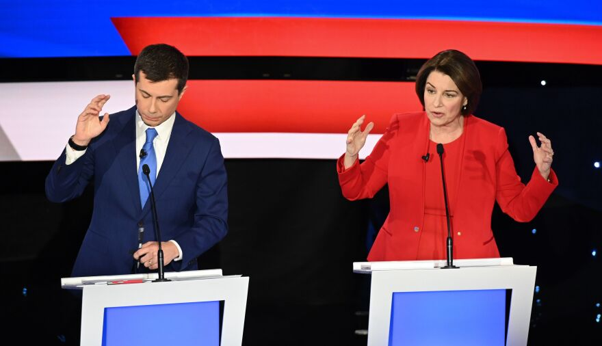 Former South Bend, Ind., Mayor Pete Buttigieg and Minnesota Sen. Amy Klobuchar speak during Tuesday's Democratic primary debate in Des Moines, Iowa.